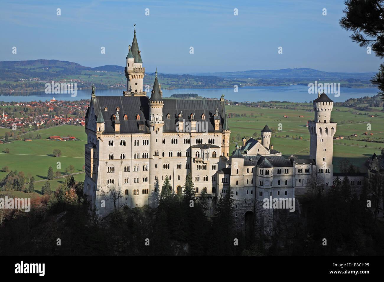 Neuschwanstein Castle Schloss Neuschwanstein lit New Swan Stone palace is a 19th century Bavarian palace Located - Stock Image