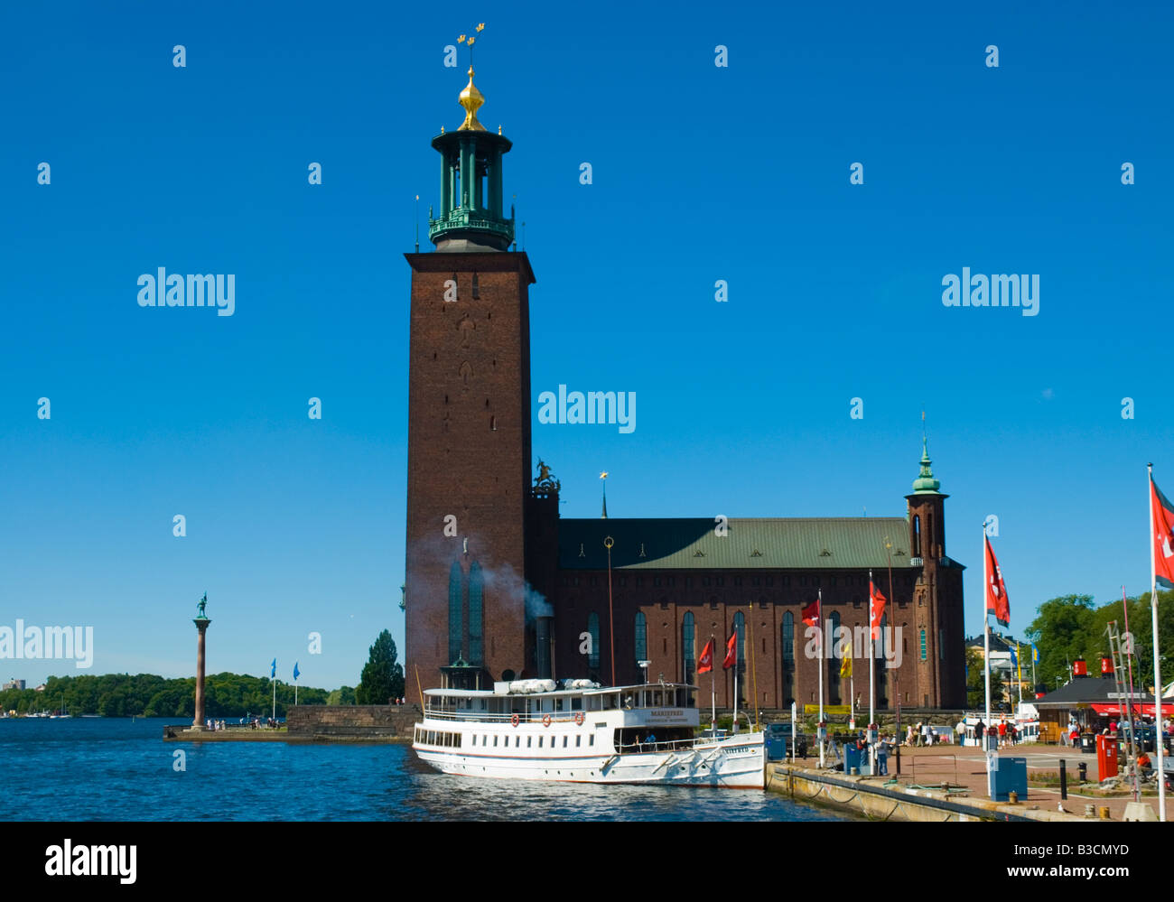 Boat anchored in front of Town Hall in Stockholm Sweden Europe Stock Photo
