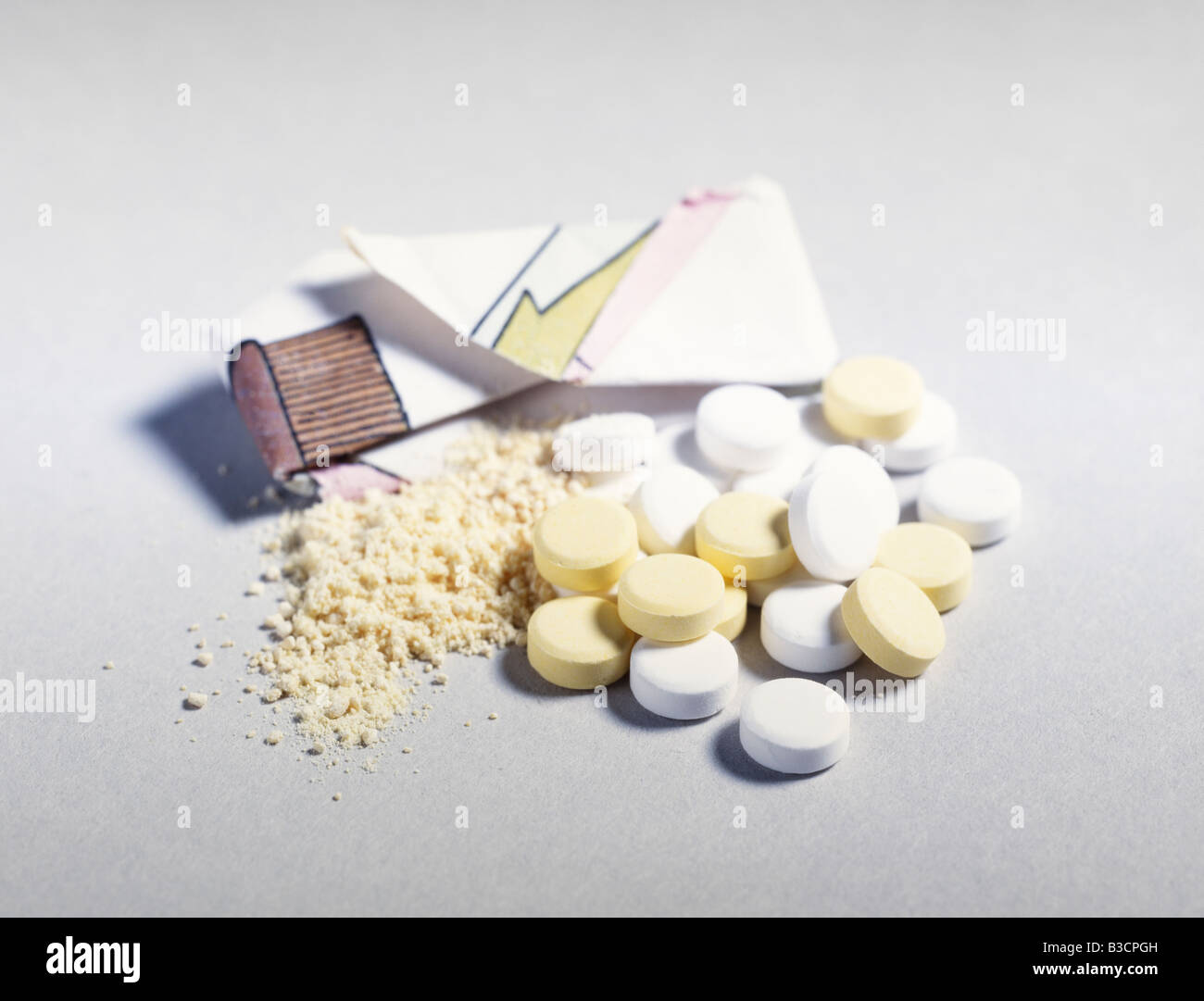Amphetamines Pills powder and a wrap - Stock Image