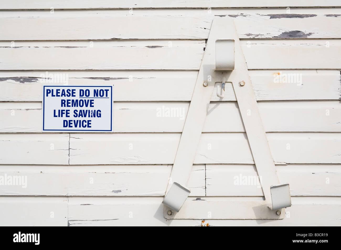Lifebelt Sign Next To An Empty Holder