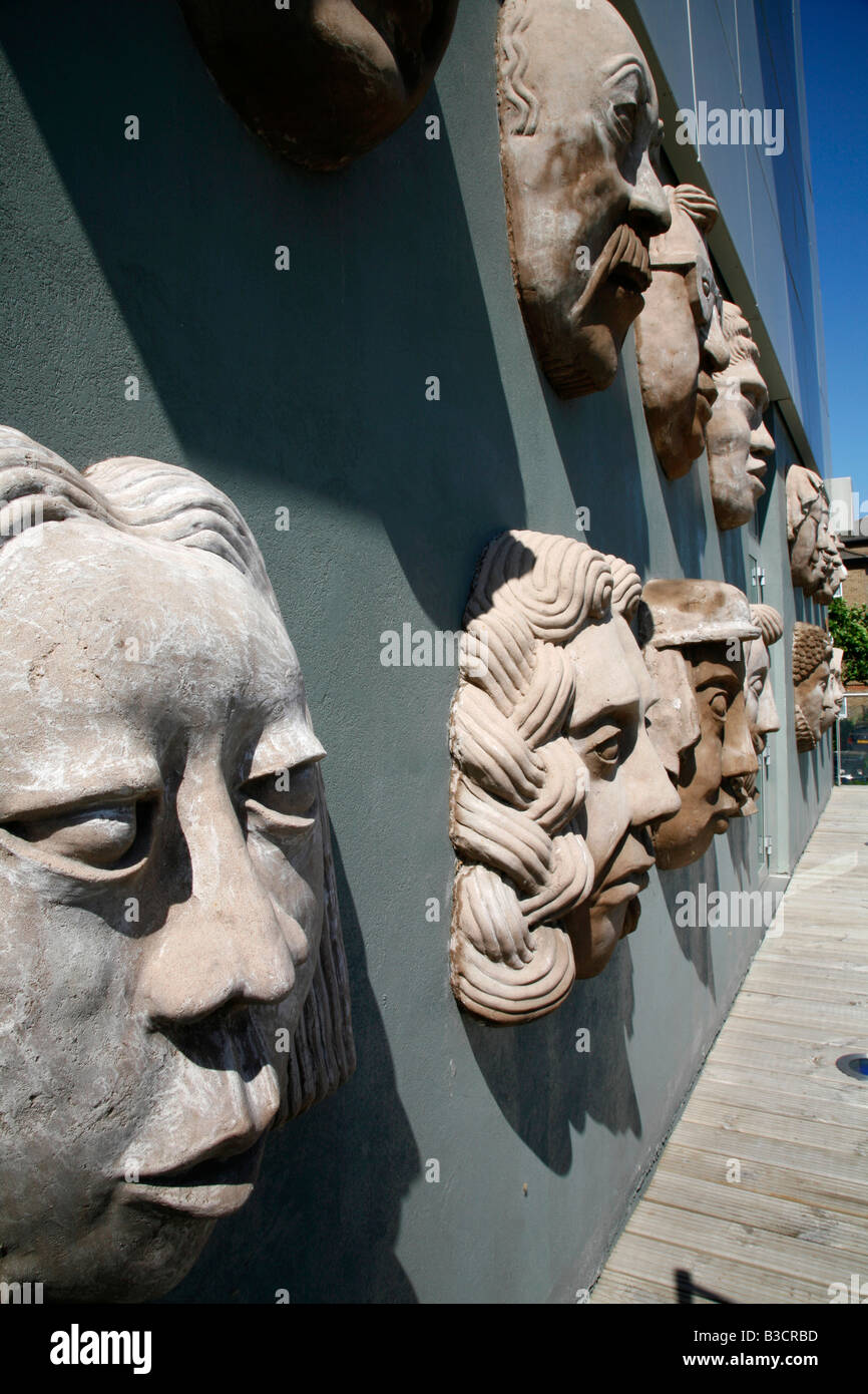 Wall of the Ancestors sculpture on the Aragon Tower, Deptford, London - Stock Image