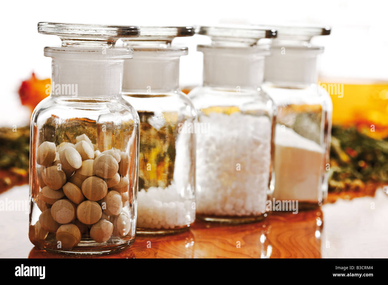 Apothecary flasks with Homoeopathic remedy, close-up - Stock Image