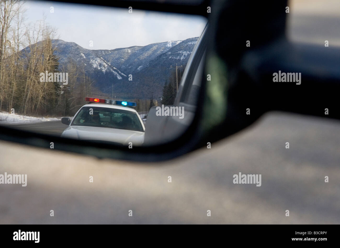 Police Car In Rearview Mirror   Stock Image