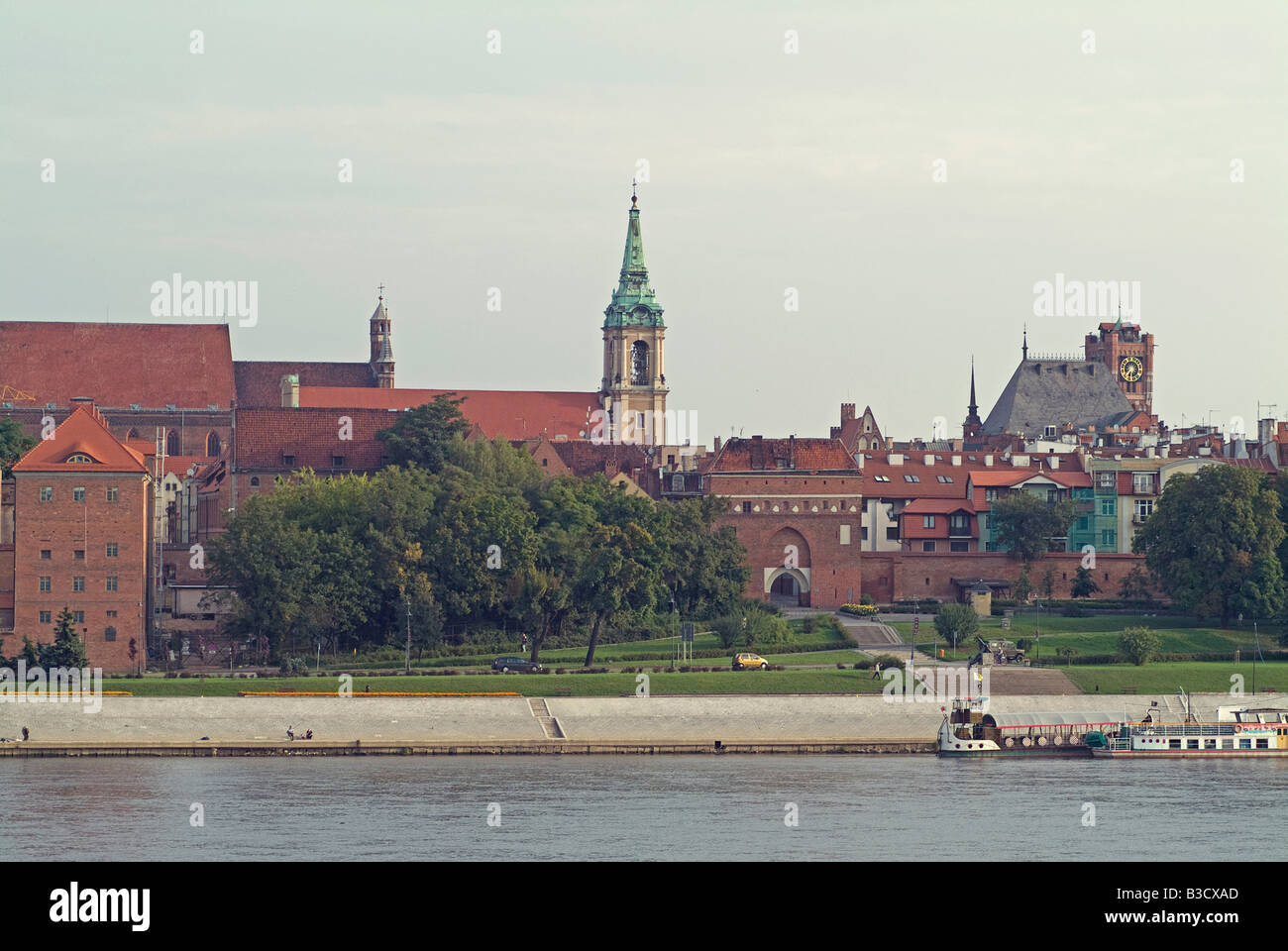 Old Town overlooking Vistula River with two ships for tourists Torun Poland - Stock Image