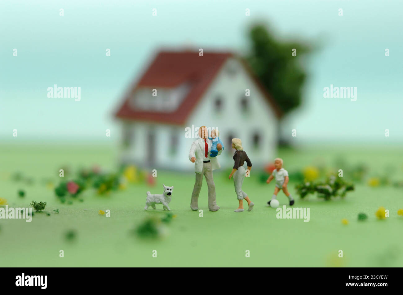 Plastic figurines in front of house - Stock Image