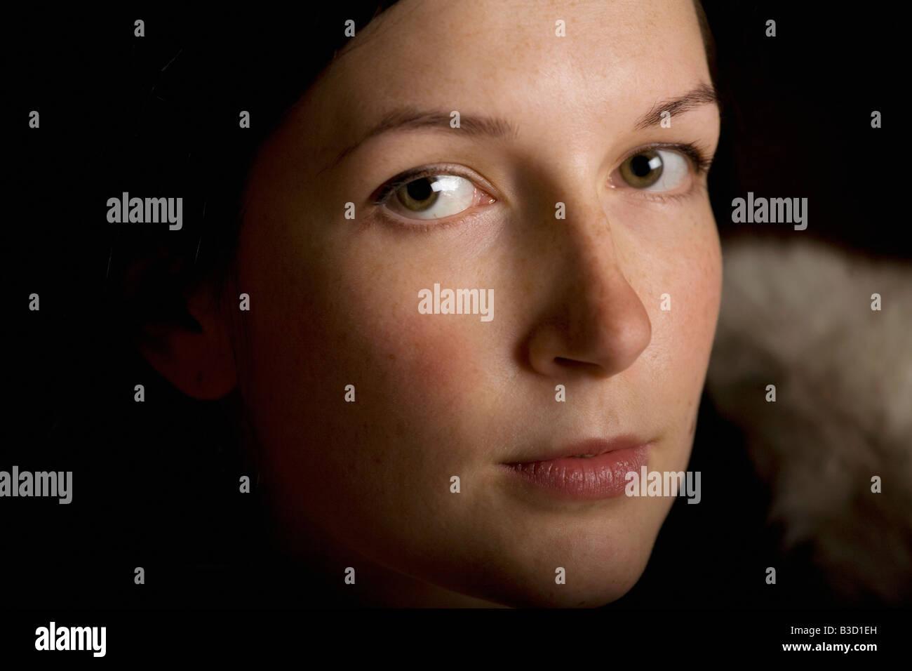 Contemplative woman, close-up, portrait - Stock Image