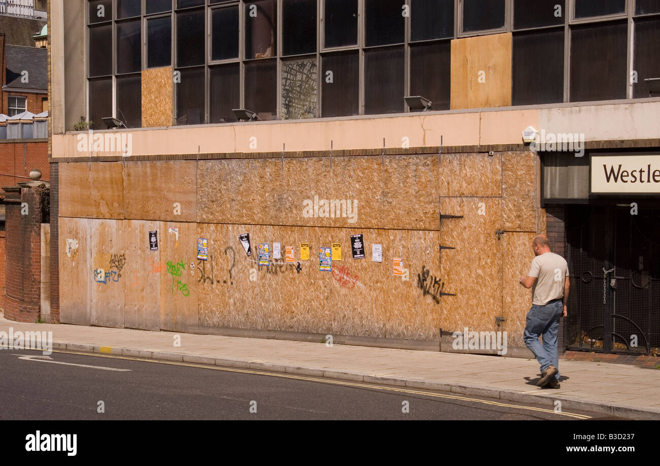 Boarded up business premises in Westlegate,Norwich,Norfolk,Uk - Stock Image
