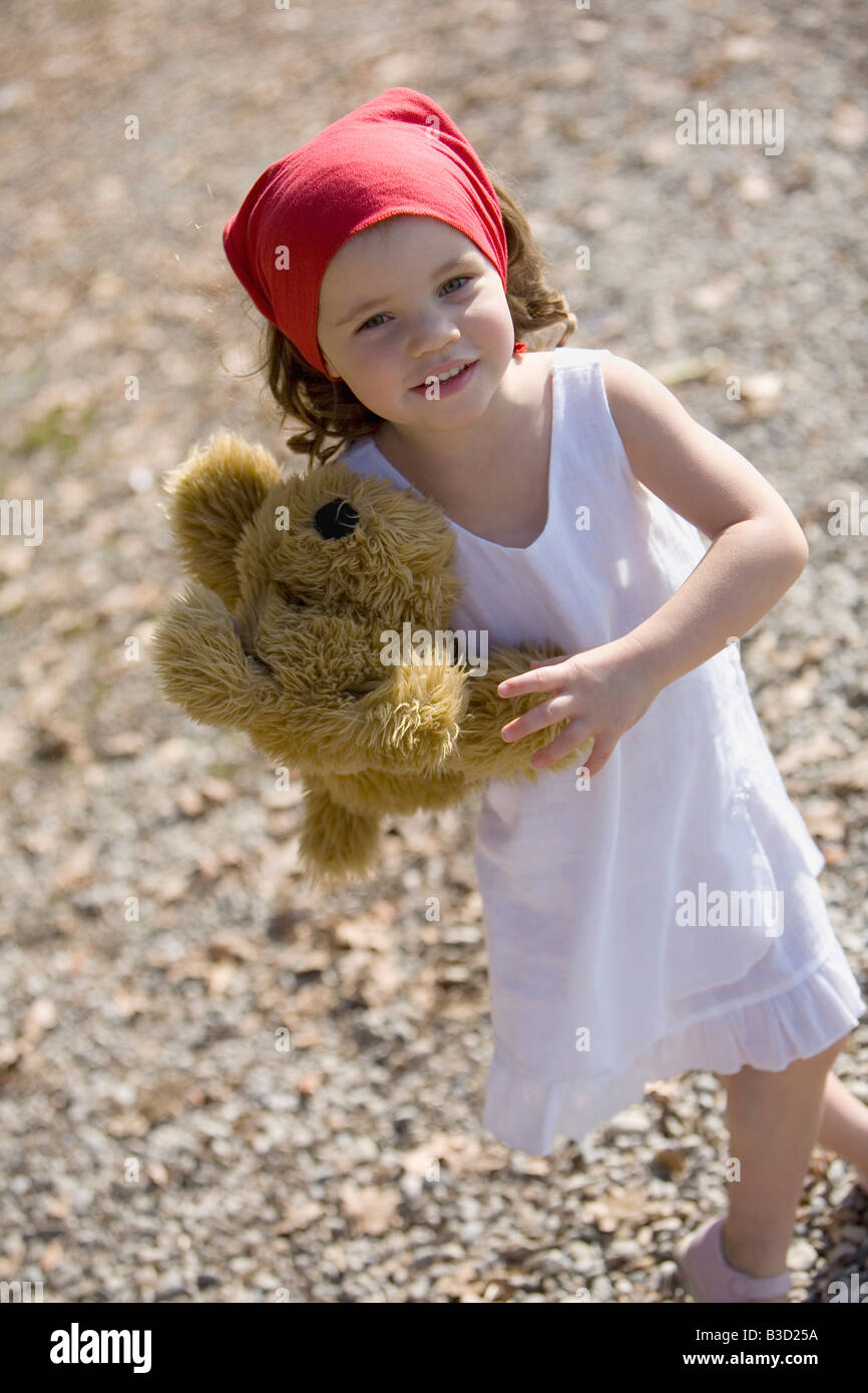 Germany, Bavaria, Ammersee, little girl (3-4) with teddy bear - Stock Image