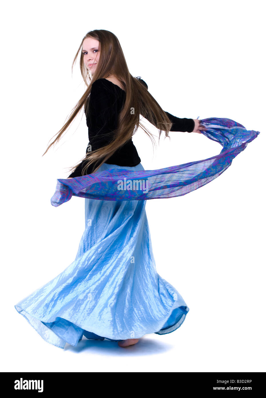 Young woman dancing against white background - Stock Image