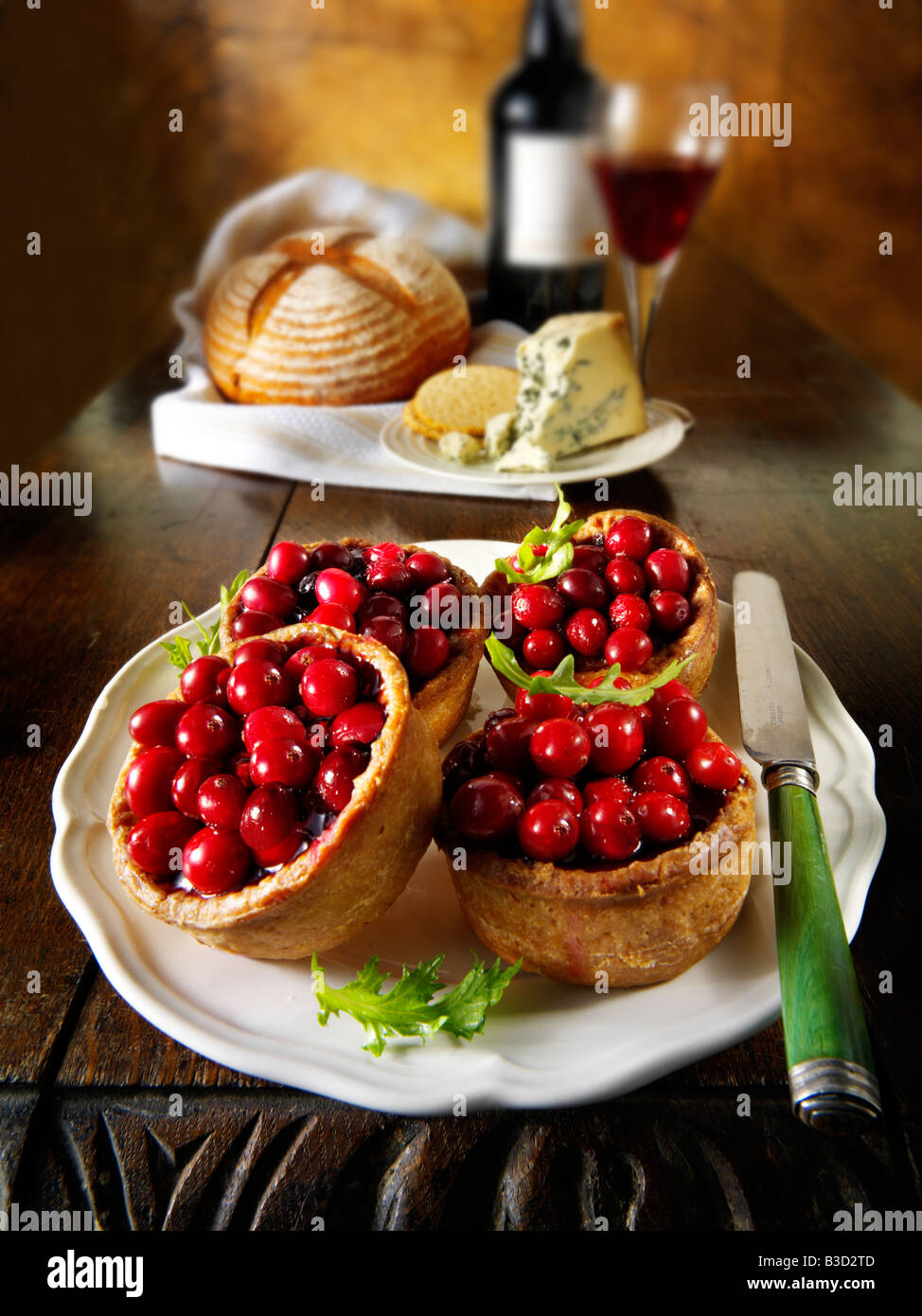 Cranberry topped pork pie - traditional British winter 'christmas food' - Stock Image
