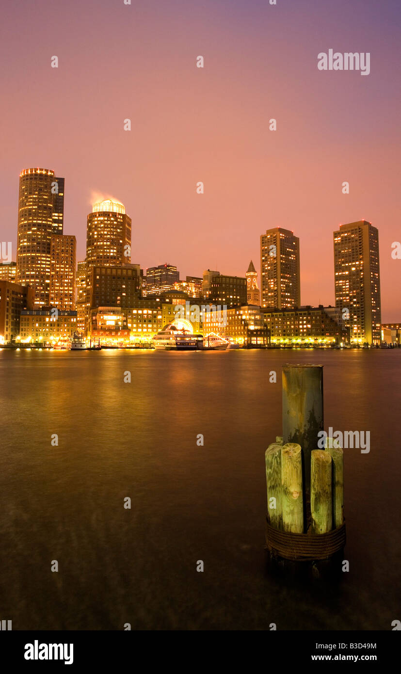 USA, Massachusetts, Boston, city skyline from harbor at dusk - Stock Image