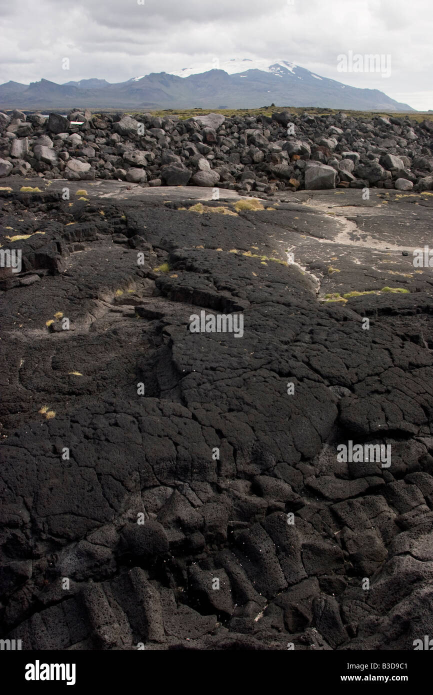 An old lava field in the background Snaefellsjokull glacier, Iceland. - Stock Image