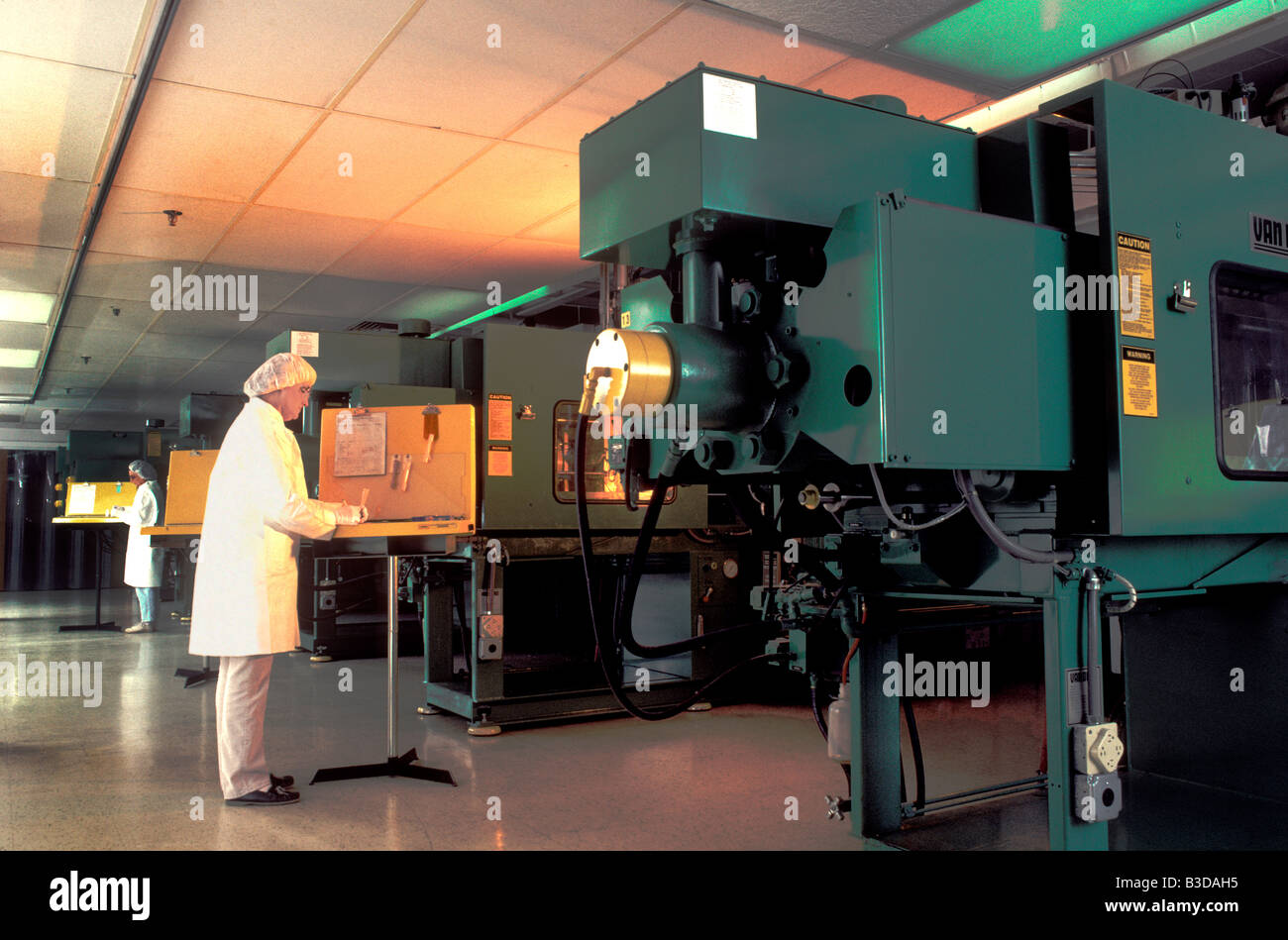Plastic injection molding - Stock Image