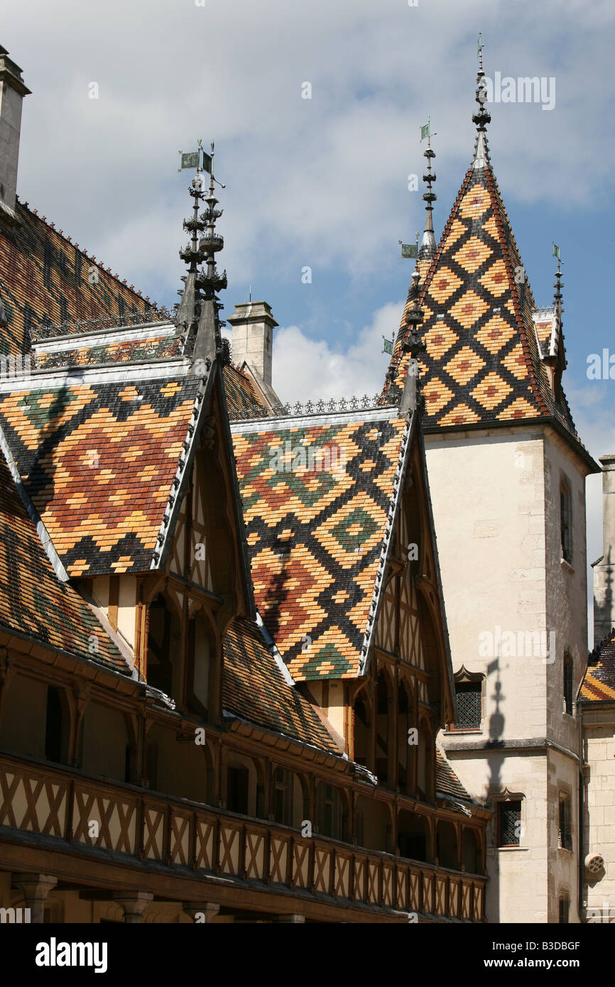 The superb Burgundian roof tiles of the Hospice Hotel-Dieu in Beaune Burgundy France Europe Stock Photo