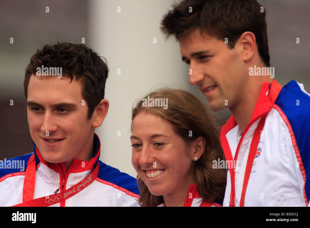 Geraint Thomas, Nicole Cooke, and Tom James, who all won gold medals at the 2008 Beijing Olympics, at a ceremony - Stock Image
