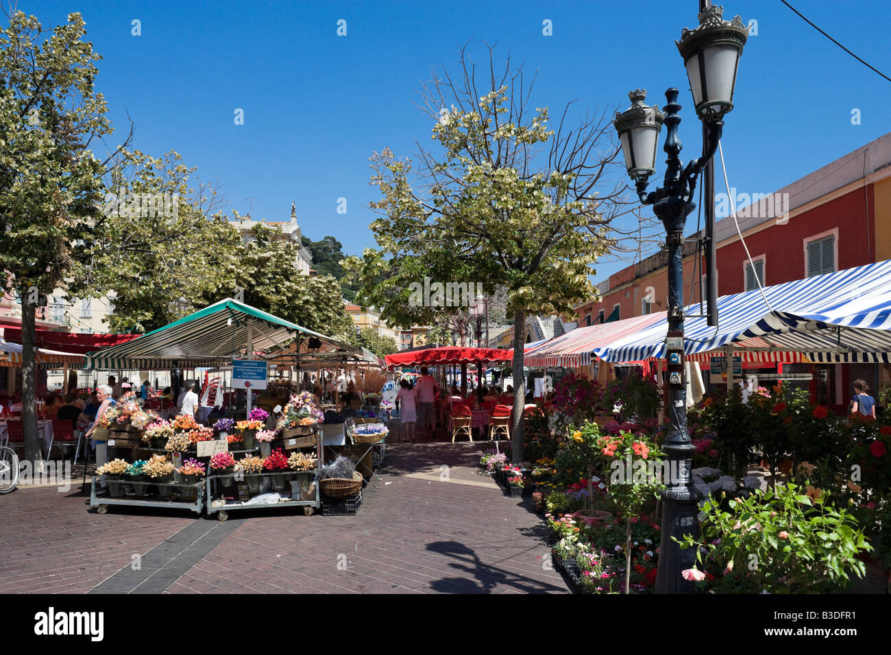 Flower stalls in the Marche aux Fleurs, Cours Saleya in the old town (Vieux Nice), Nice, Cote d'Azur, French - Stock Image