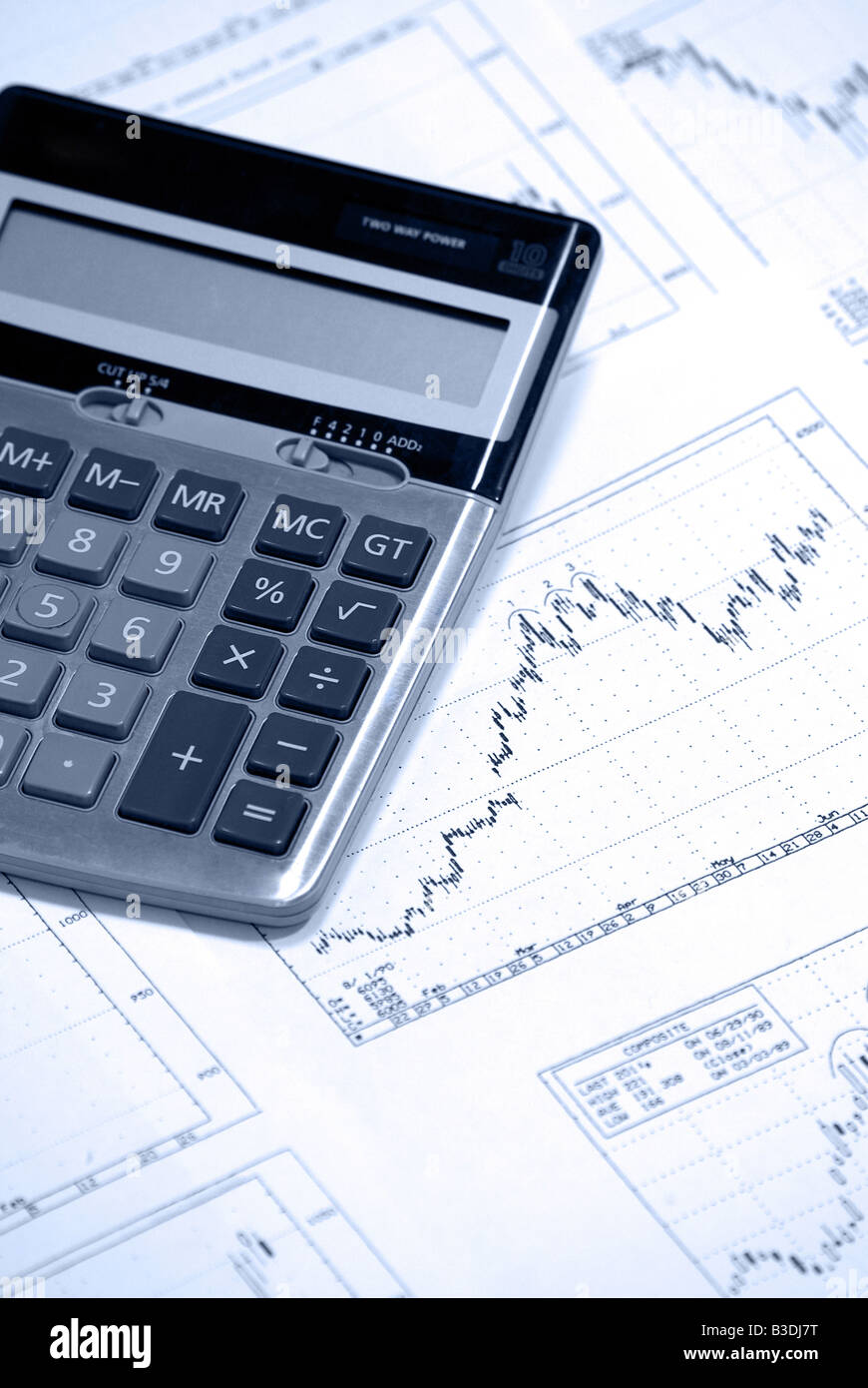 Calculator laying on stock market, market graph, graphs, chart, charts Stock Photo
