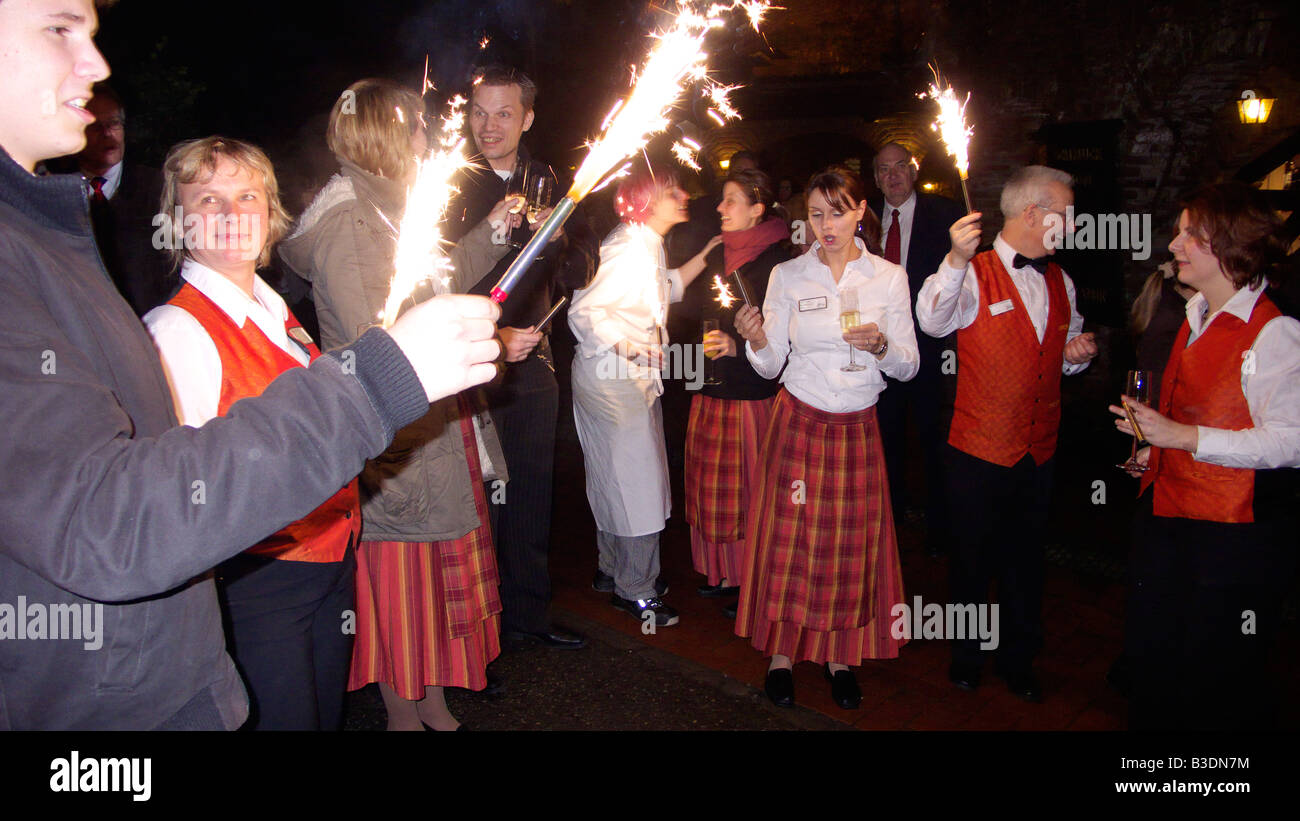 Sylvester, New Years Eve, fireworks at the Hotel Gut Hoehne, hotel guests celebrate the turn of the year together - Stock Image