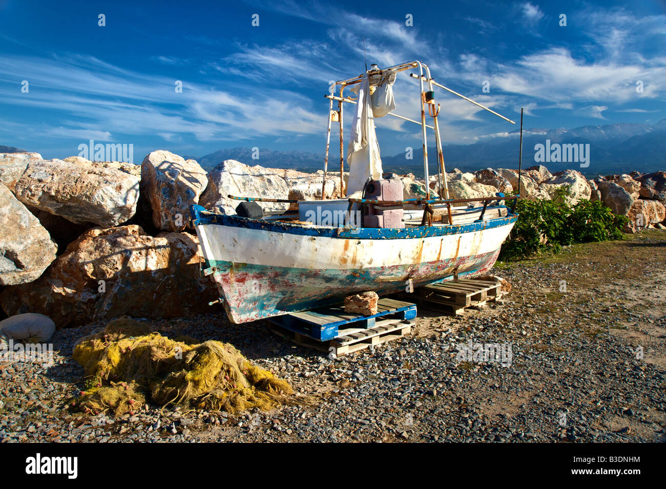 Old fisher boat at the popular beach of Marathi western Crete - Stock Image