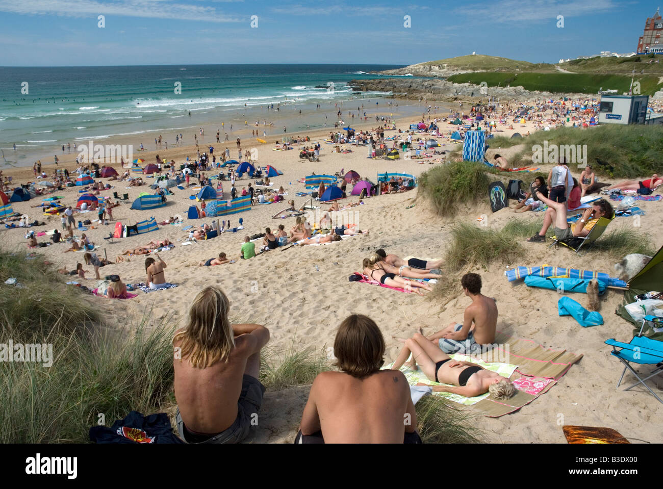 Summer holiday crowds Fistral Beach Newquay Cornwall England UK - Stock Image
