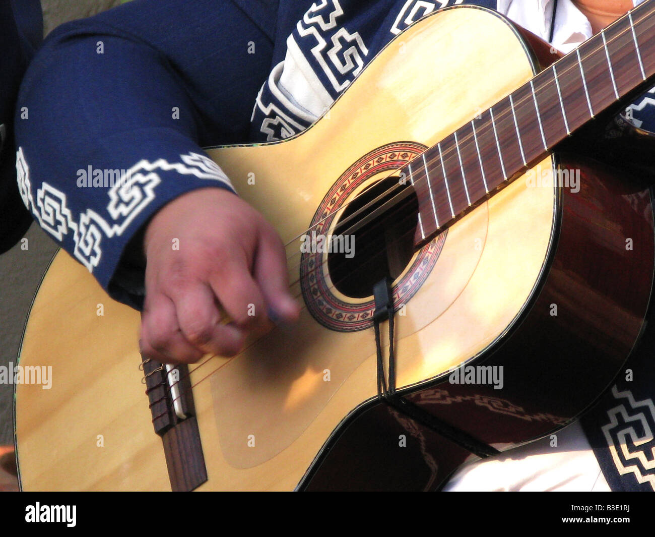 Close up of a mariachi guitar player - Stock Image