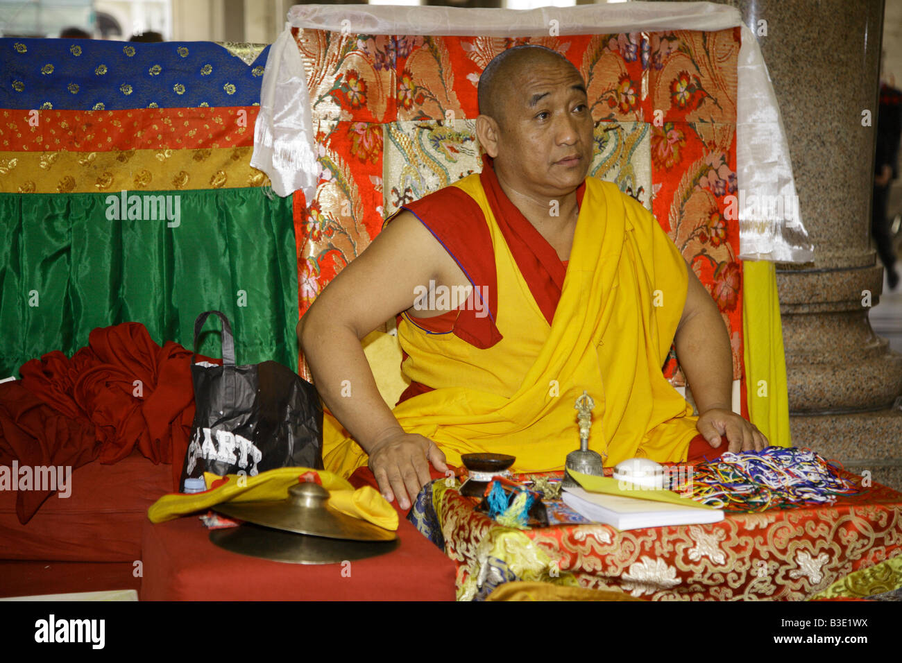 Tibetan Buddist monk in yellow and red robes - Stock Image