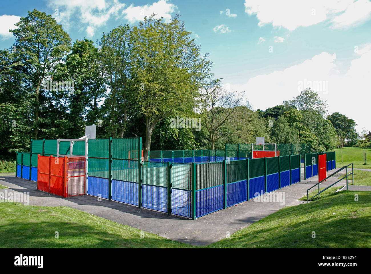 an enclosed sports pitch in taylor park,st.helens,merseyside,uk - Stock Image