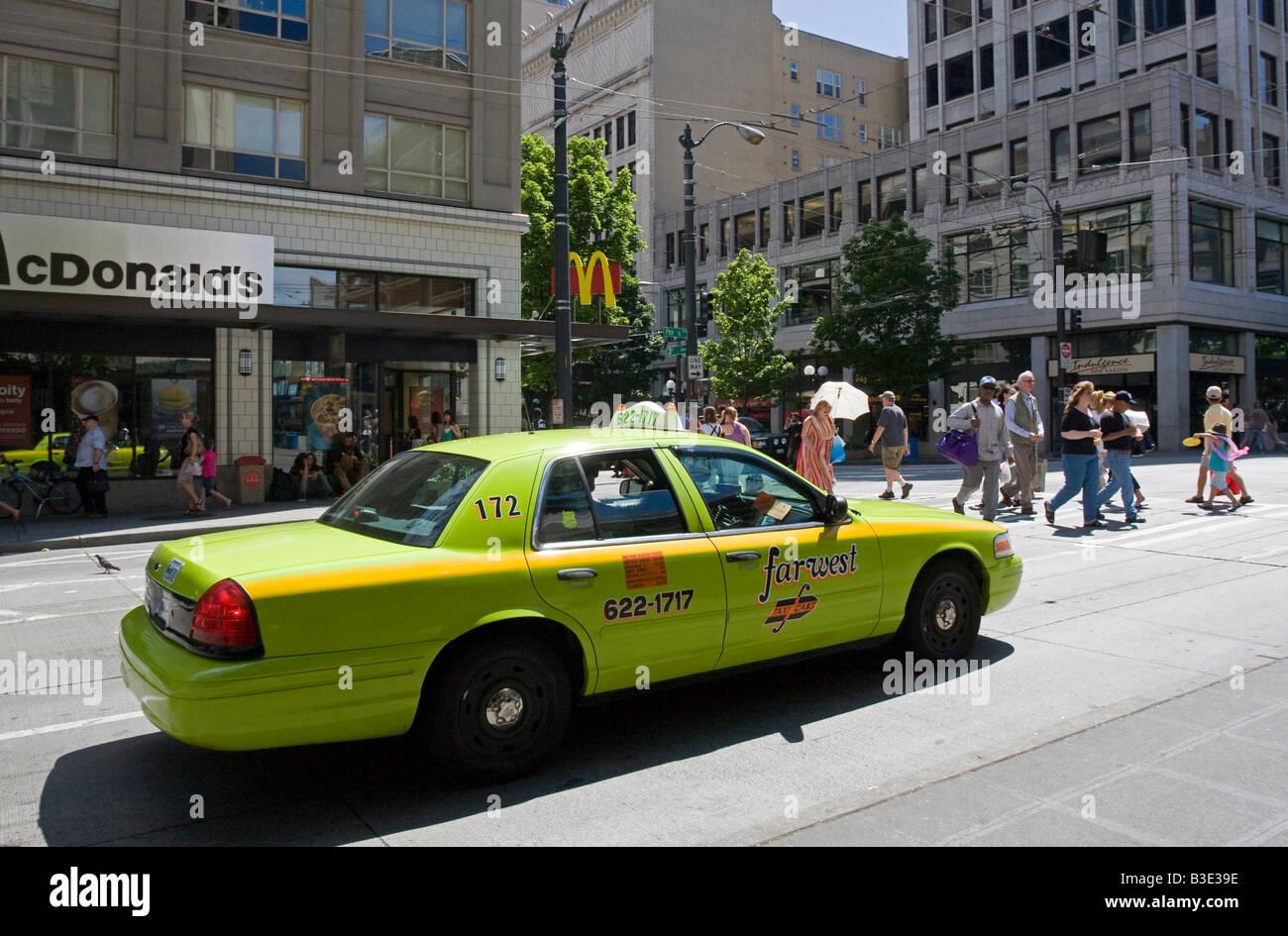 Lime Green Taxicab in sunny Seattle street Washington State WA USA - Stock Image