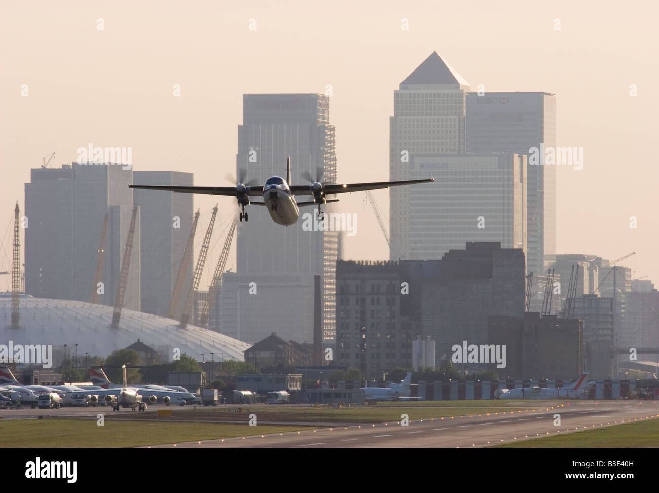 VLM Airlines Fokker 50 F 27 050 taking off from London City Airport - Stock Image