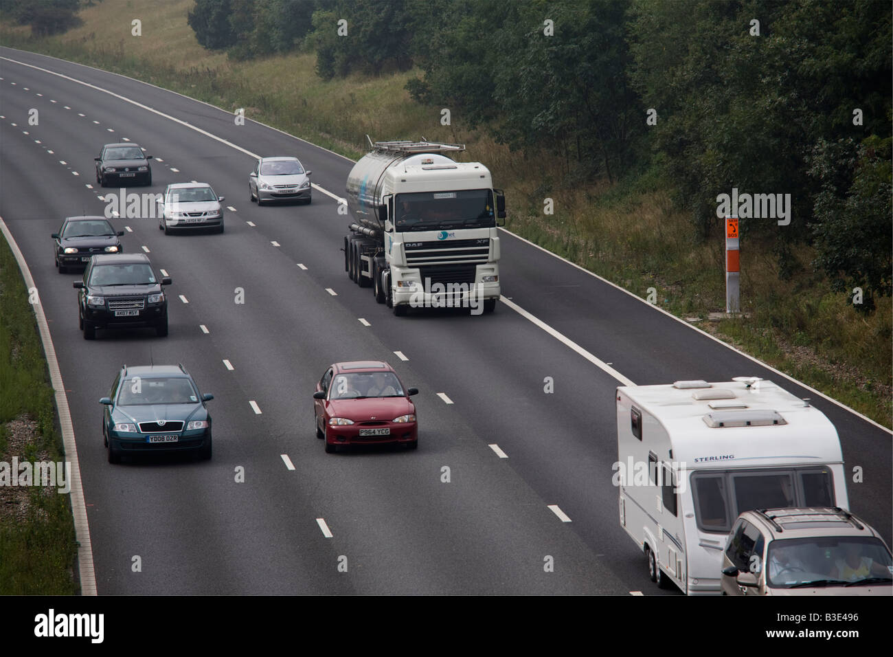 Traffic travelling on M25 motorway on dull sunday Essex GB UK - Stock Image