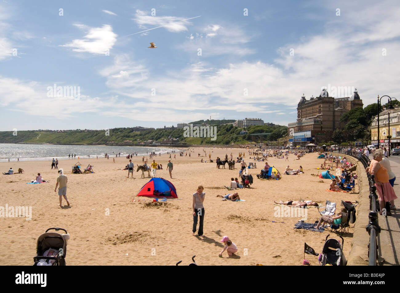 scarborough south beach traditional english seaside holiday town uk north yorkshire sunny day sand sandy day out - Stock Image