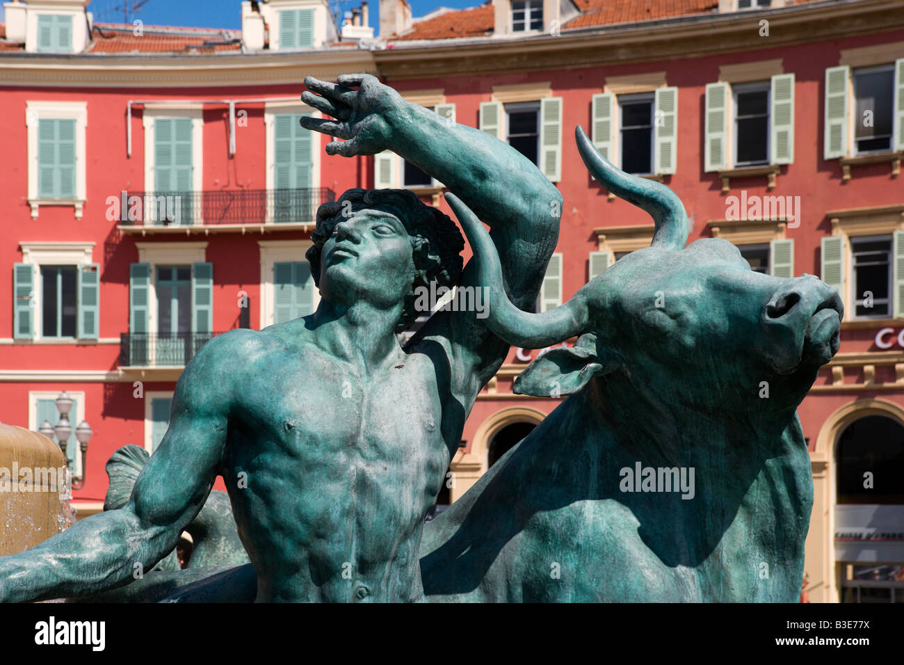 Statue on a fountain with Italianate buildings behind, Place Massena, Nice, Cote d'Azur, French Riviera, France Stock Photo