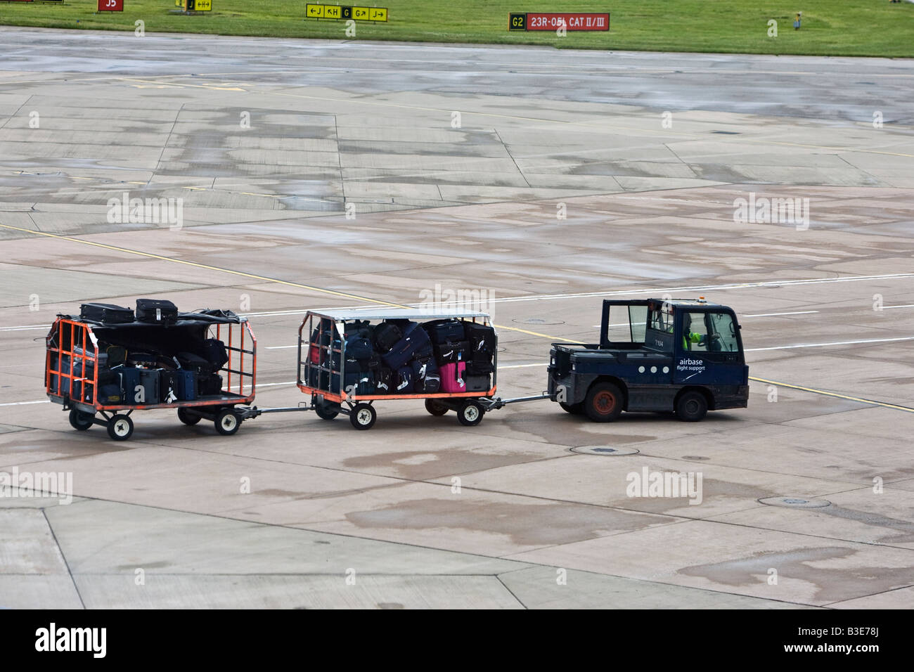 baggage Handler Manchester Airport Airside Luggage - Stock Image