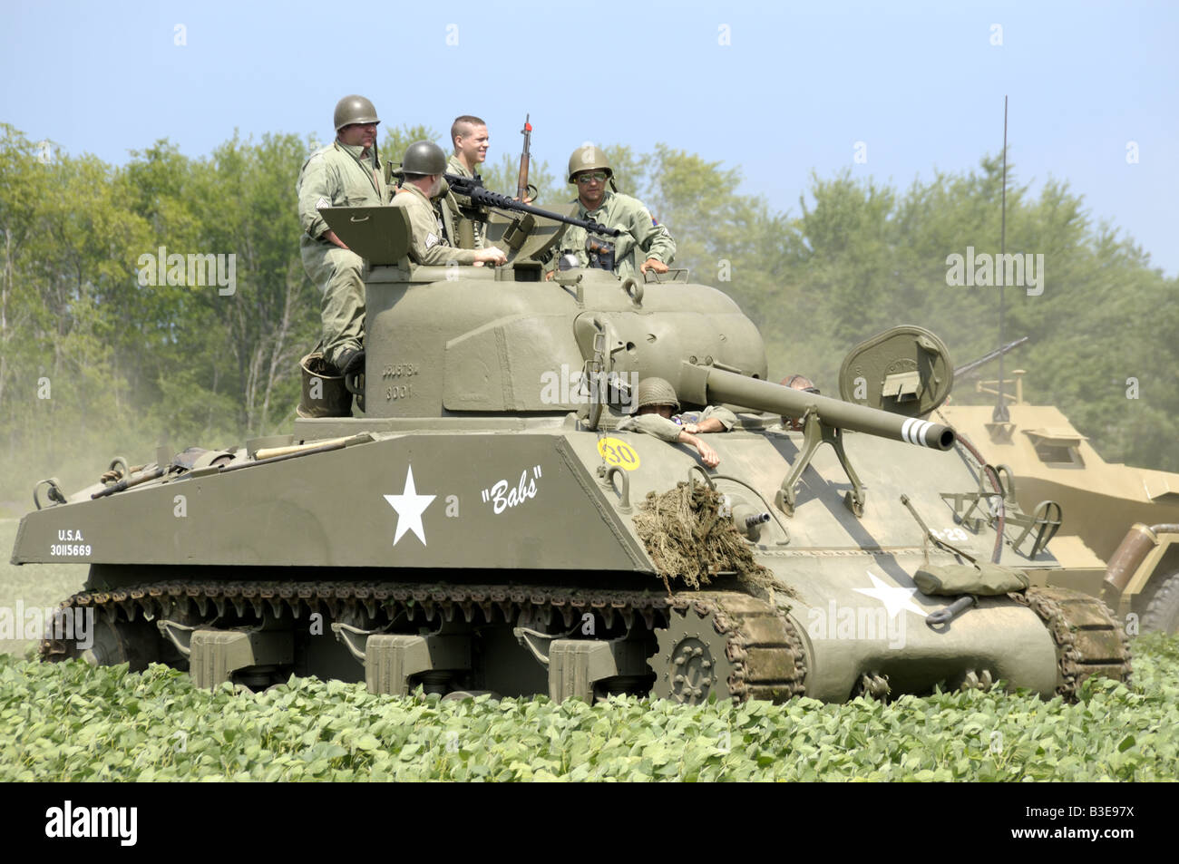 American soldiers aboard an American tank during a WWII reenactment in Bellville, Michigan - Stock Image