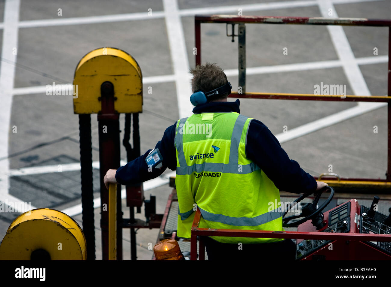 Luggage Handler Manchester Airport Air side - Stock Image
