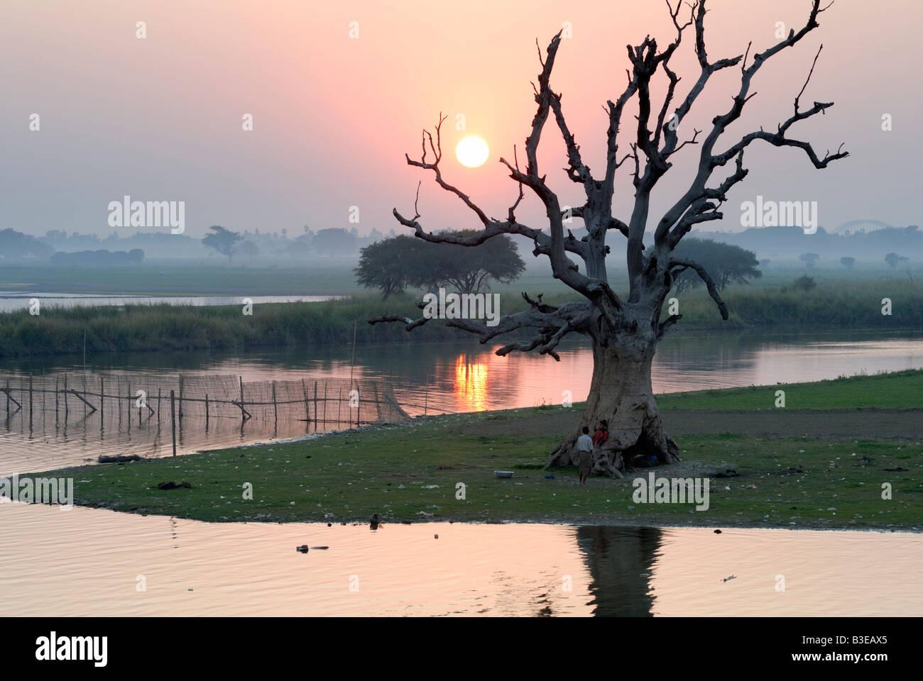 sunset view of Thaungthaman Lake, Amarapura, Myanmar (Burma) - Stock Image