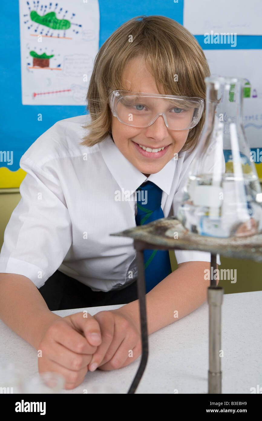Boy in chemistry lesson - Stock Image
