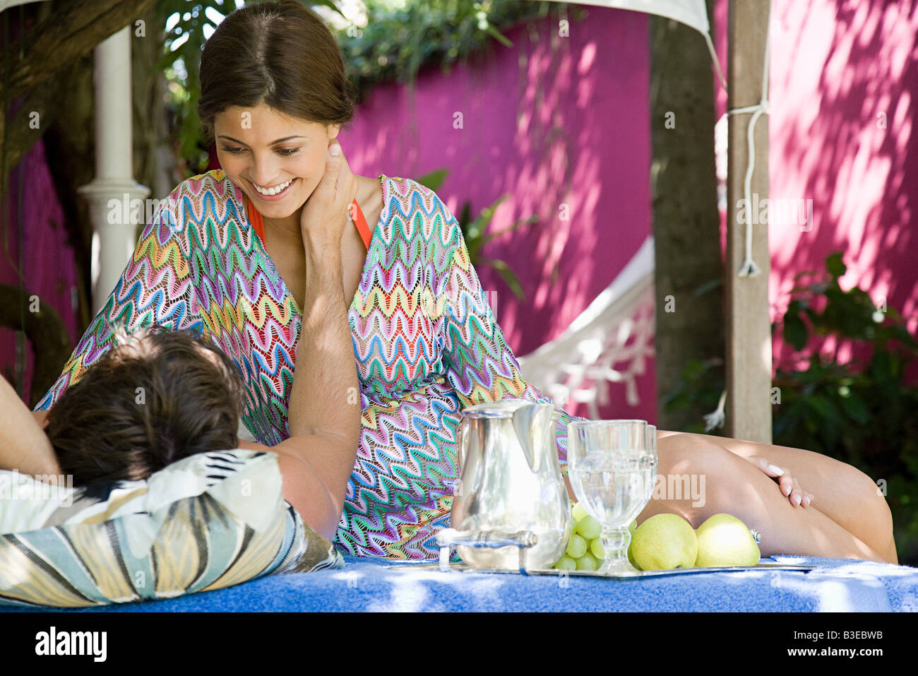 Intimate couple in the shade - Stock Image