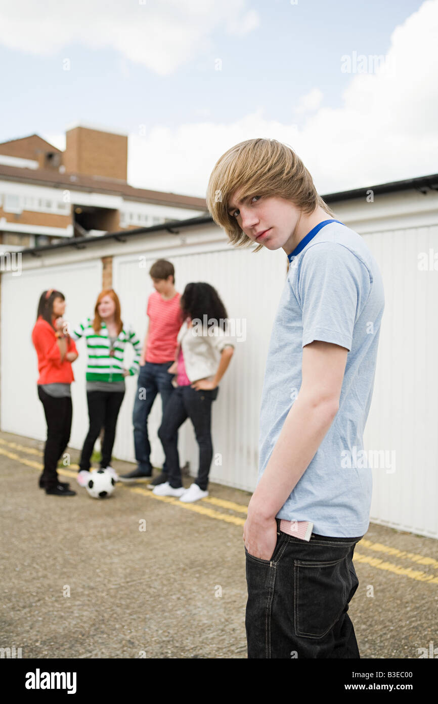 Teenagers by garages Stock Photo