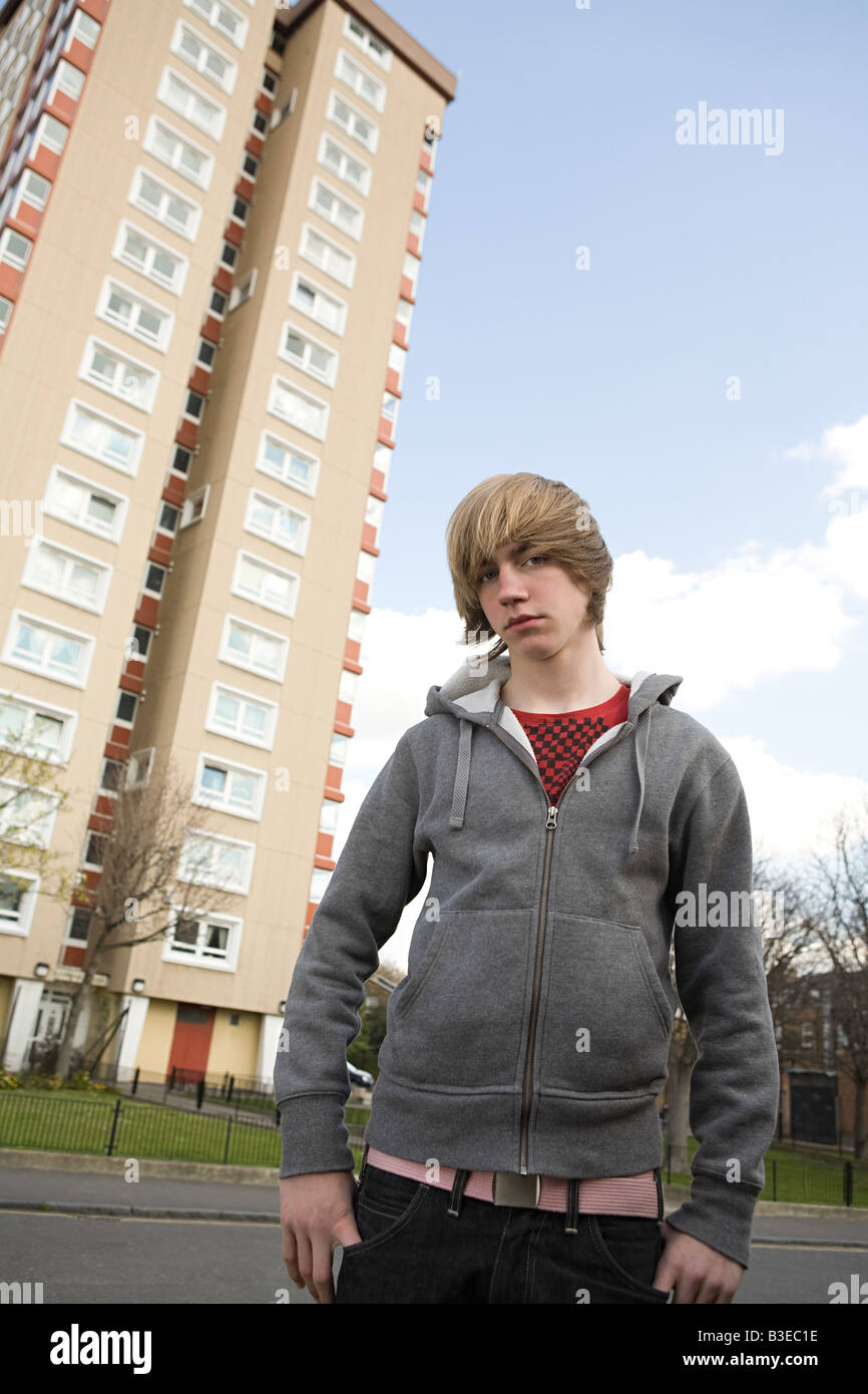 Boy by tower block - Stock Image