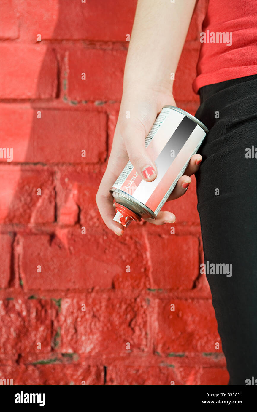 Girl with spray paint - Stock Image