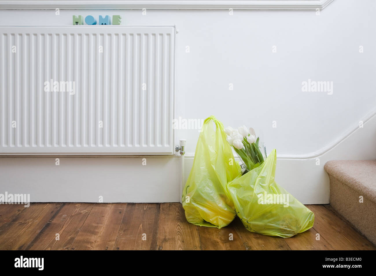 Shopping bags in house - Stock Image