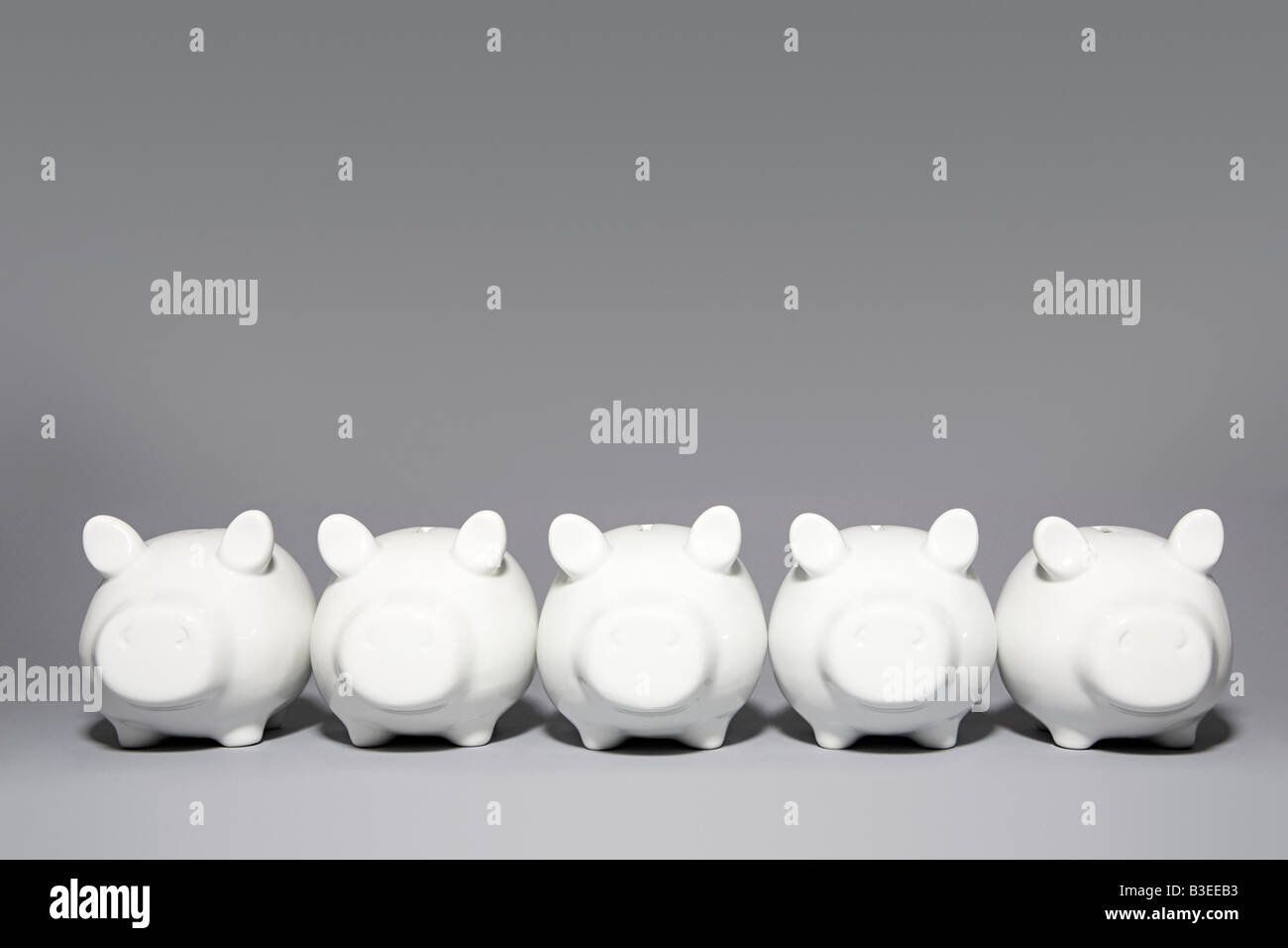 Five piggybanks in a row - Stock Image