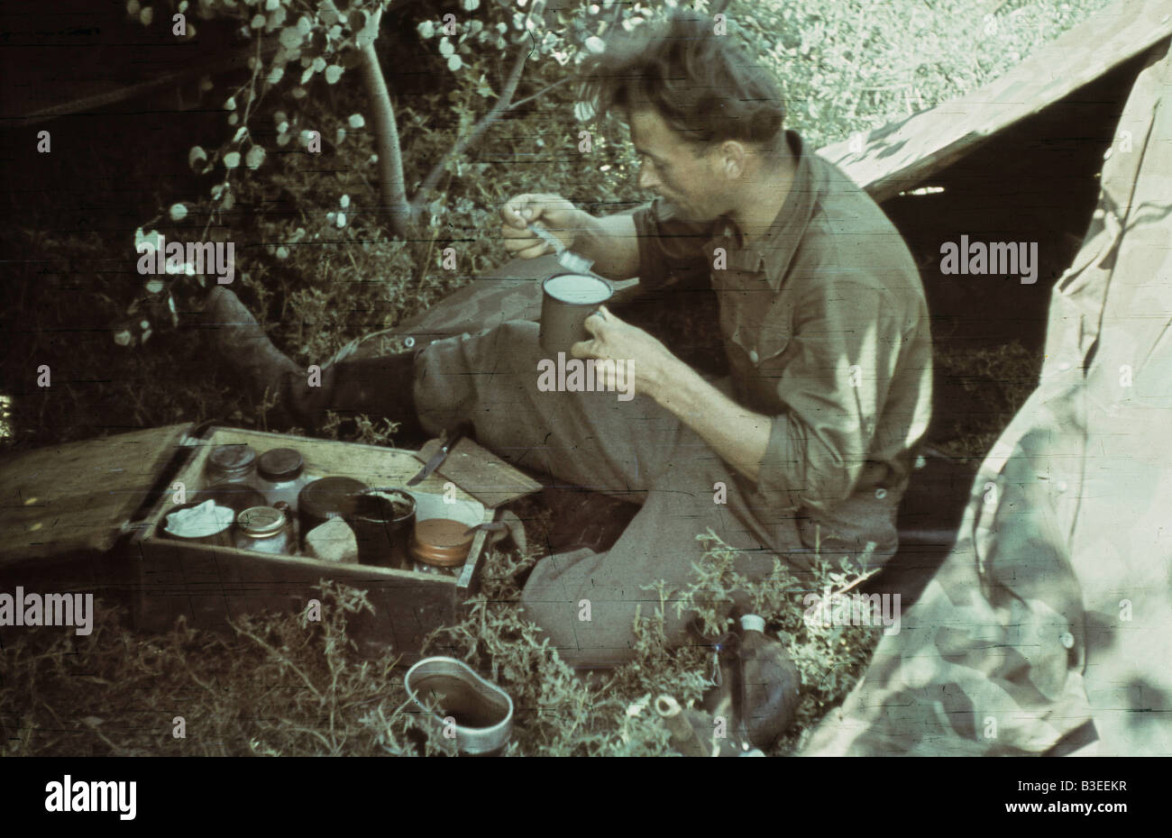 Soldier having breakfast / WWII / 1941 - Stock Image