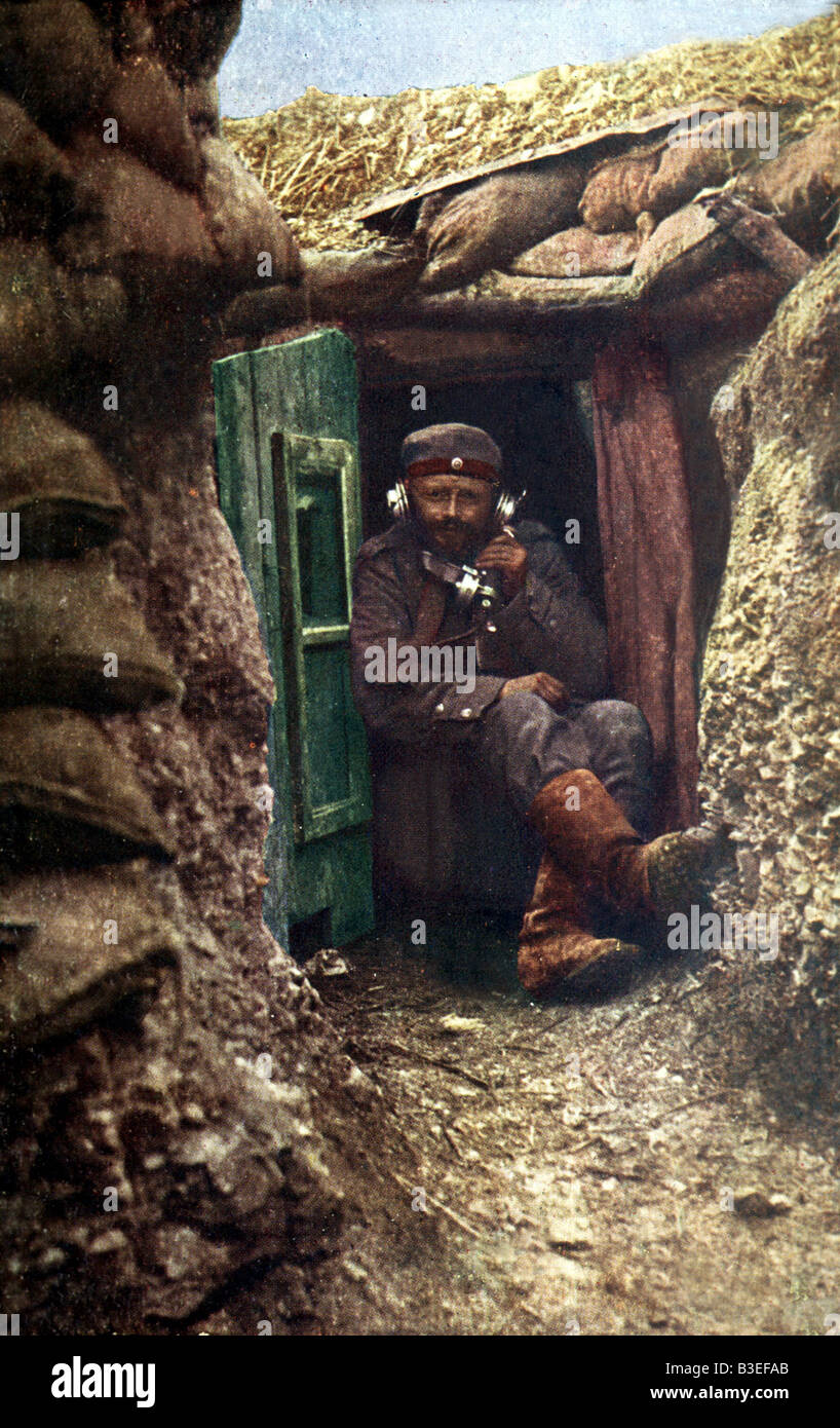 events, First World War / WWI, Western Front, German soldier with field telephone in a trench, photo postcard, Germany, 1915, Stock Photo