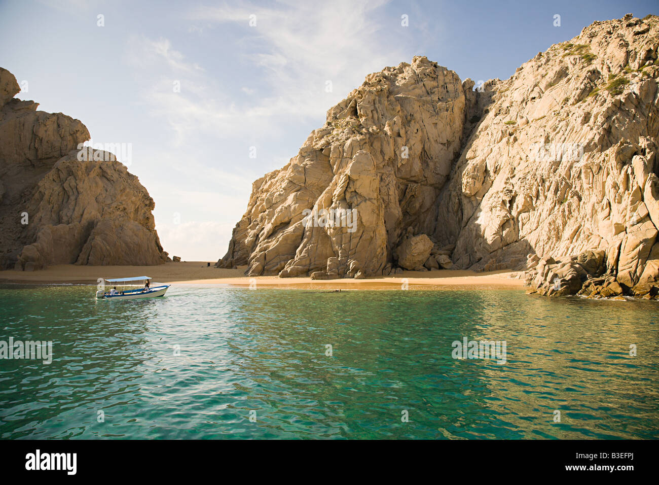 Boat at secluded beach - Stock Image