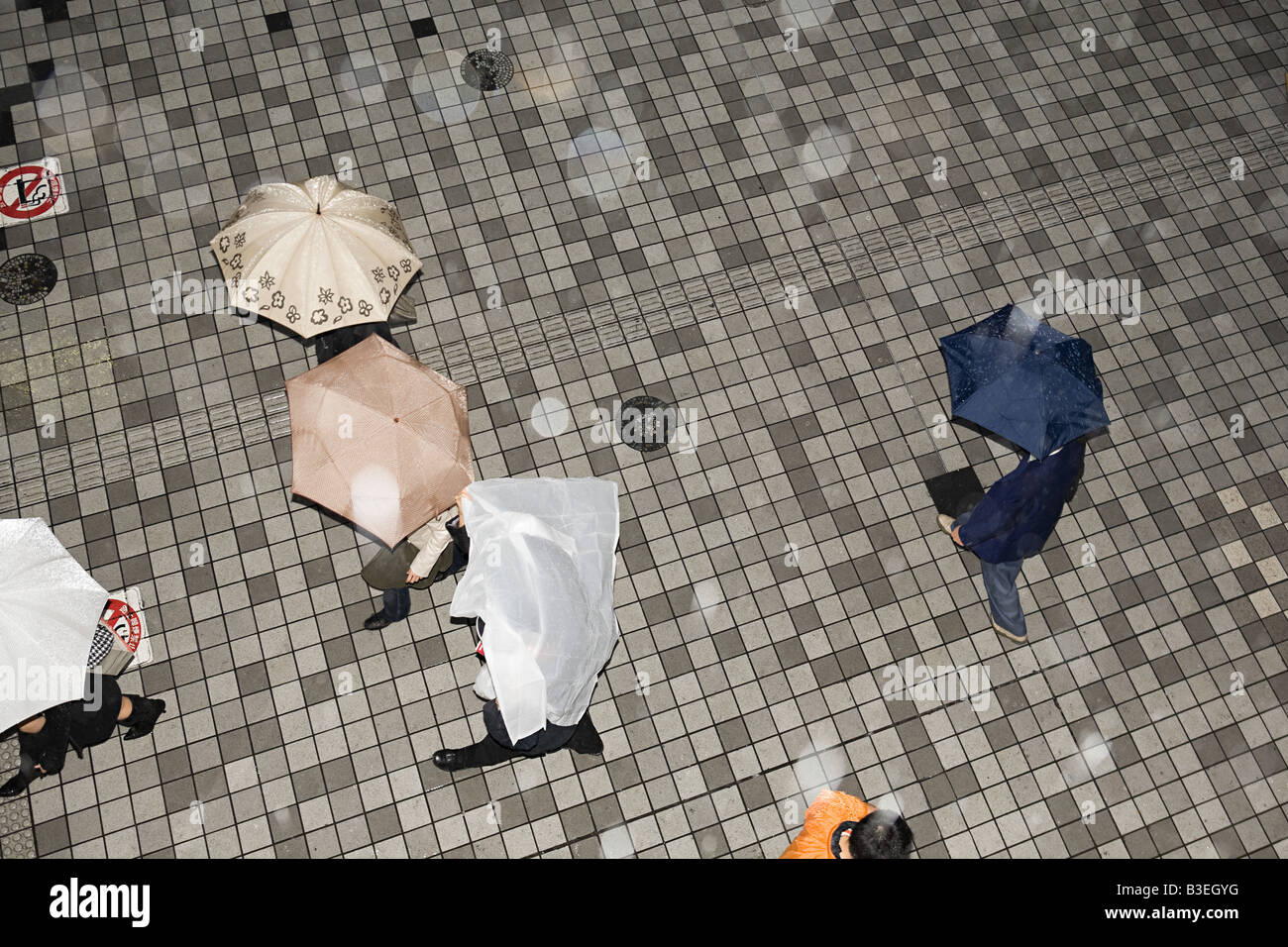 People with umbrellas - Stock Image