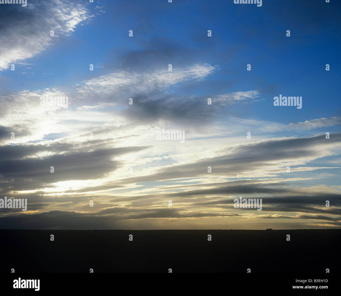 Clouds over land - Stock Image