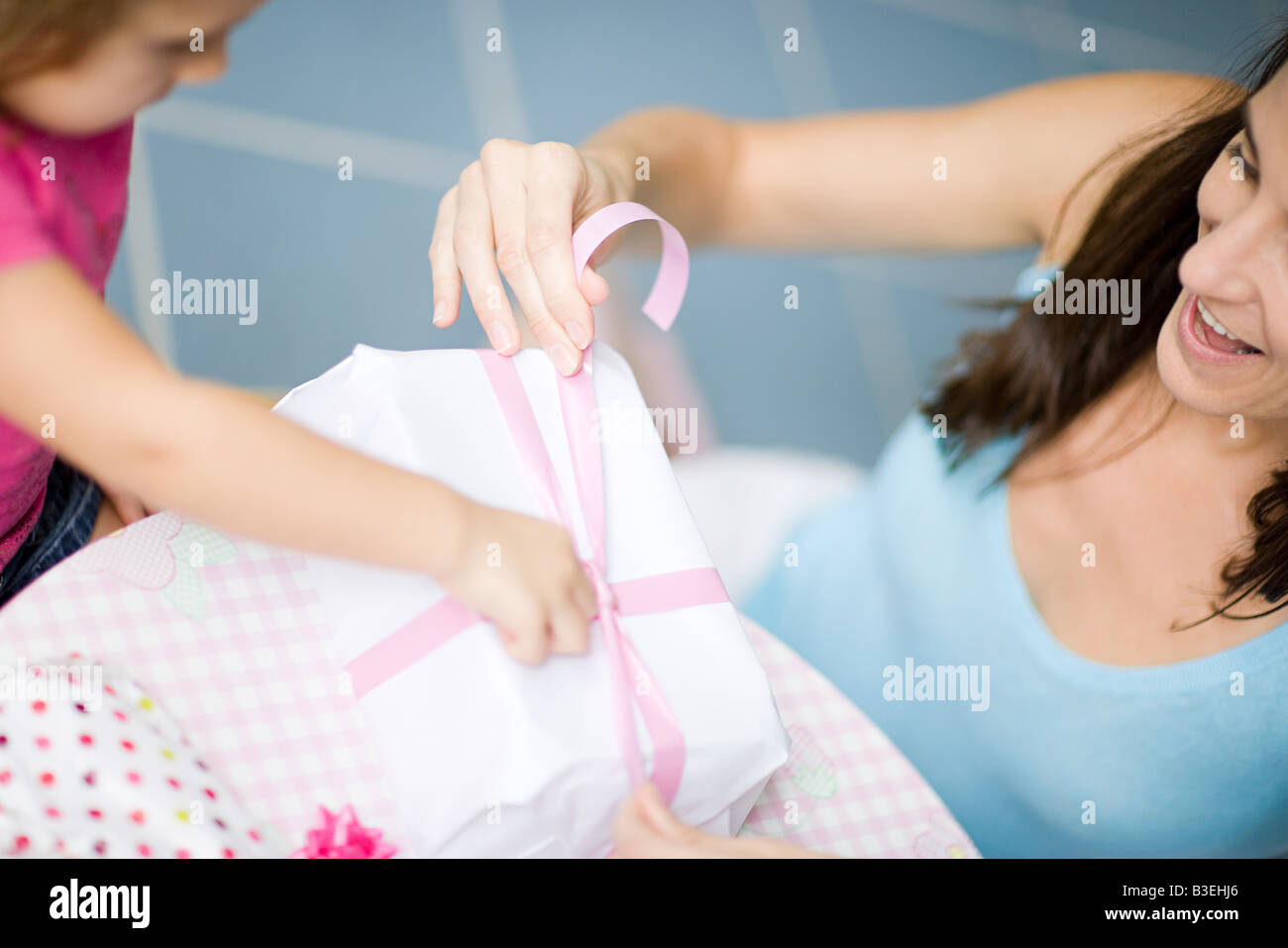 Girl and mother with birthday gift - Stock Image