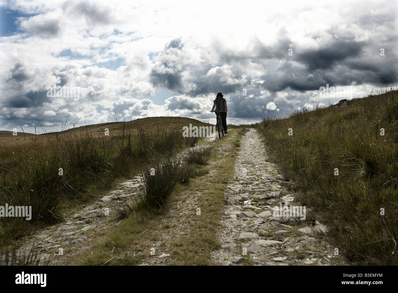 Cyclist on the north end of Jura Inner Hebrides Scotland UK - Stock Image